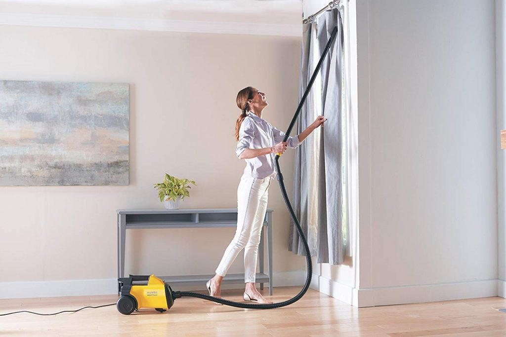Eureka vacuum cleaning with flexible hose used in cleaning windows