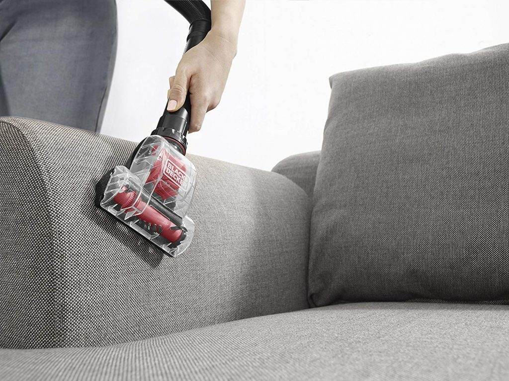 Ultra light weight black an decker vacuum cleaner used in cleaning the chair or couch