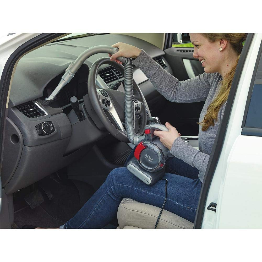black and decker vacuum cleaner with flexible hose used in cleaning the car