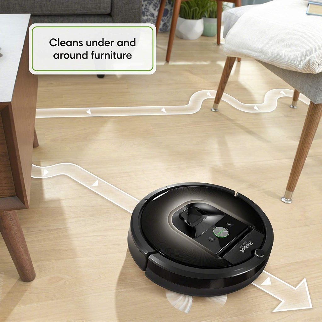 The iRobot 980 vacuum cleaner cleaning under furnitures