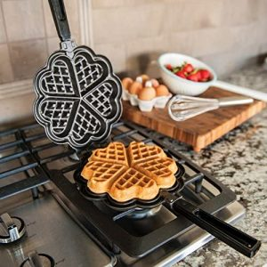 Nordic ware waffle maker on gas stove